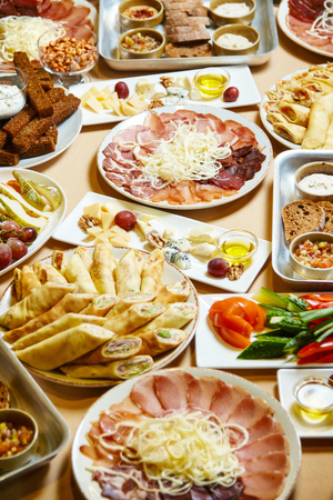 a lot of delicious food on the table, buffet, feast