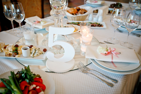 beautiful holiday wedding feast with candles and flowers Banco de Imagens