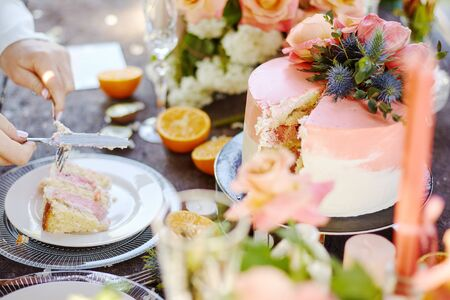 wedding decor on a table with cake, candles and fruits