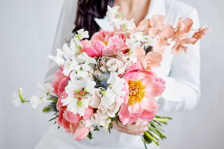 Beautiful bride with a wedding bouquet is very happy