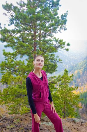 Girl on a mountain walk on a forest Stock Photo