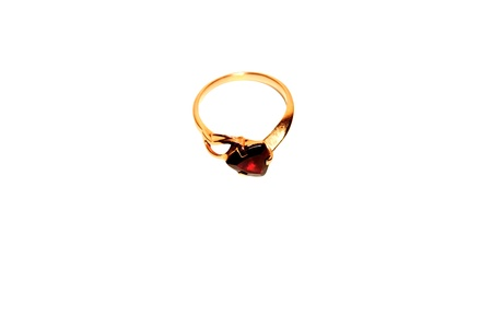 Gold ring with red stone. Isolate