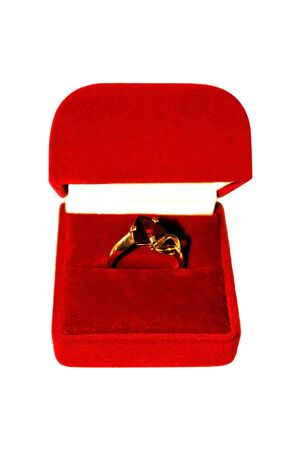 Gold ring with red stone in the red box.