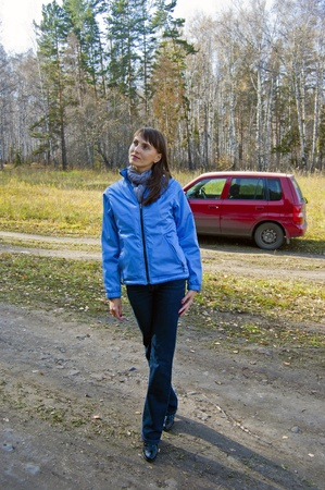 The woman got out for a walk in the woods Stock Photo