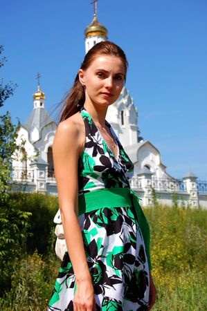 The woman on the background of the Russian Orthodox Church Stock Photo