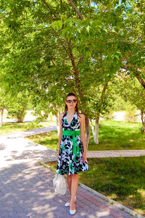 clr: A girl on a sunny day. Bright colors. The summer.