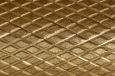 Metal cylindrical surface embossed honeycomb texture  Fragment  Crop  Bronze background
