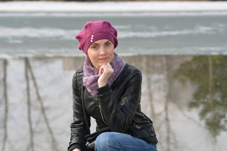 Woman in pink beret and black leather jacket on a walk Stock Photo