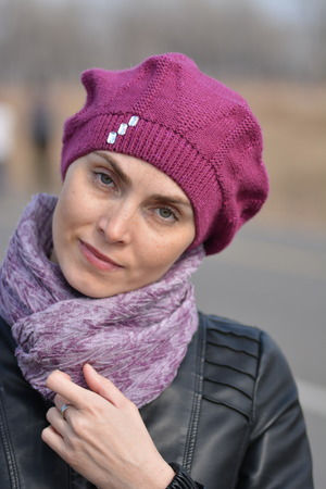 Woman in pink beret and black leather jacket