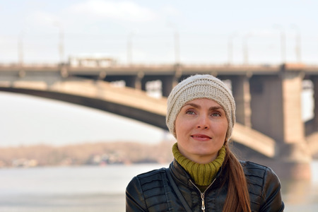 Woman on the background of the bridge