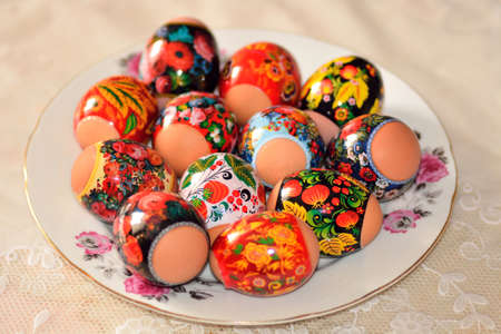 Easter eggs on a plate standing on the tablecloth