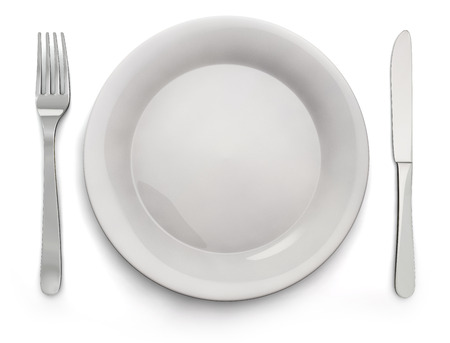Empty white plate with silver knife and fork  Isolated and clipping path included  photo