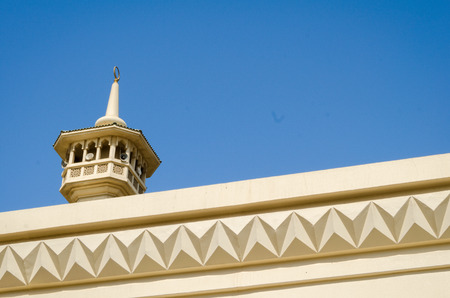 Mosque Minaret in Dubai Traditional Bastakiya District on clear sky blue background. Stock Photo