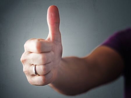 Thumb up hand approval symbol. 스톡 콘텐츠