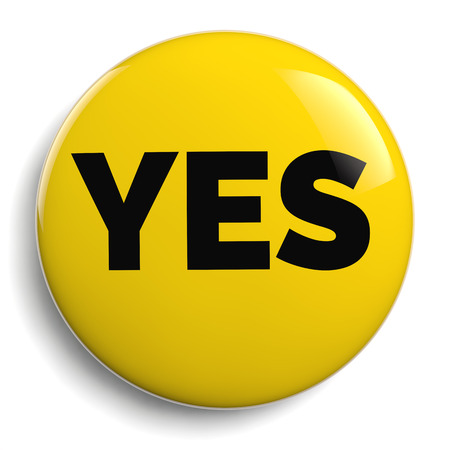 Yes Sign Text on Yellow Campaign Button Stock Photo