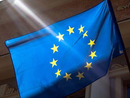 European Union Flag Closeup with Sunlight on Building Wall 版權商用圖片