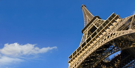 Always awesome... the Eiffel Tower against a radiant blue sky Stock Photo - 4180090