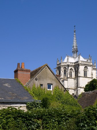 common people: Common people and Nobility concept. One of the humble houses of Amboise with the Cathedal at background.