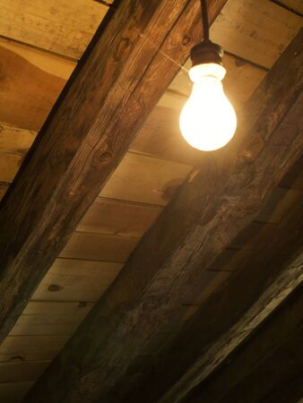 Electric Bulb in a Wooden Roof Stock Photo - 4198630