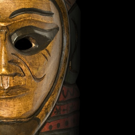 Beautiful handmade mask from Africa on a black background Stock Photo - 4239415
