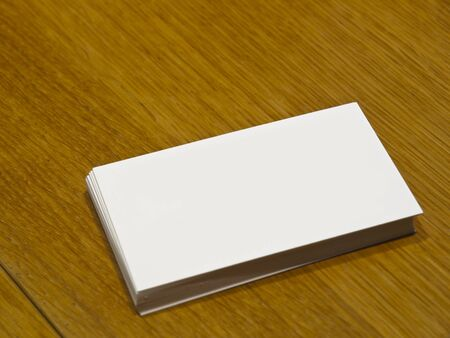 table surface: Blank Business Card on a wooden table