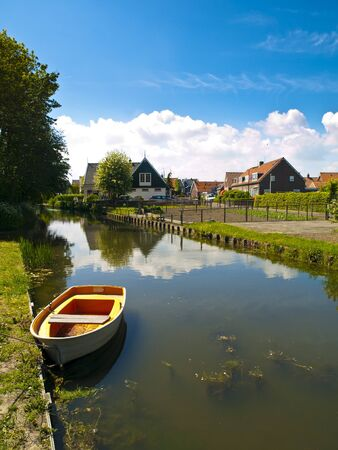 Marken is a peninsula in the IJsselmeer, the Netherlands, located in the municipality Waterland in the province North Holland. It is a former island, which nowadays is connected to the North Holland mainland by a causeway.  photo