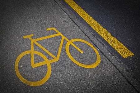 bicycle lane: Bicycle road mark in a grey asphalt