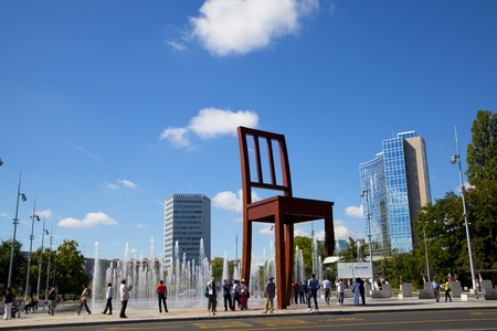 landmine: Geneva, Switzerland - August, 17th 2011: Broken Chair monument in the Place des Nations Unies square in Geneva, Switzerland. Broken Chair is a monumental sculpture in wood by the Swiss artist Daniel Berset, constructed by the carpenter Louis Genève.