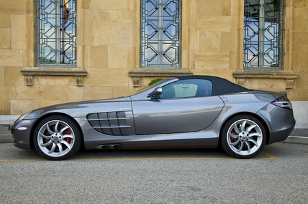 Neuchatel, Switzerland - August 10, 2011: Silver Mercedes McLaren SLR parked at the entrance of Hotel Beau-Rivage in Neuchatel, Switzerland. This anglo-German sports car is developed by Mercedes-Benz and McLaren Automotive.