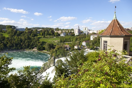 rhein: The Rhine Falls are 150 m wide and 23 m high. The Rhine Falls were formed in the last ice age, approximately 14,000 to 17,000 years ago, by erosion- resistant rocks narrowing the riverbed. Stock Photo