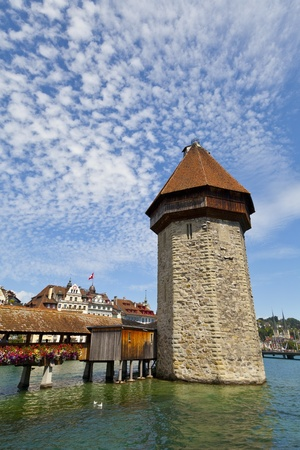 lucerne: The Chapel Bridge (Kapellbrucke) is a covered wooden footbridge spanning diagonally across the Reuss River in the city of Lucerne in central Switzerland. Stock Photo