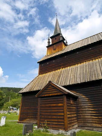 shorter: Kaupanger stave church (Kaupanger stavkyrkje) is the largest stave church in the Sogn og Fjordane, and is situated in the town of Kaupanger, Norway. The nave is supported by 22 staves, 8 on each of the longer sides and 3 on each of the shorter. The elevat