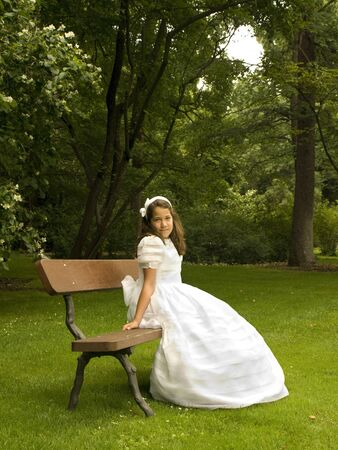 Beautiful girl in her first communion day photo