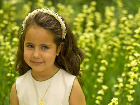 Little girl in the meadow photo