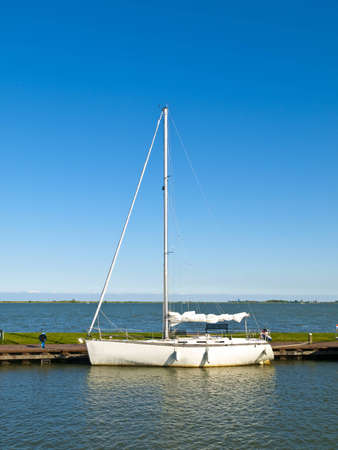 furled: Moored Sailboat in the pier of Marken, Netherlands