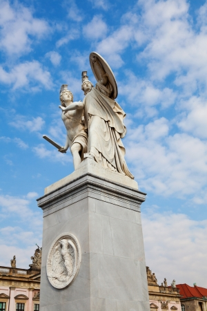 Pillar Statue in Schlossbruke Bridge in Berlin by Gustav Blaeser  1854  which shows a young hero protected by Athena  photo