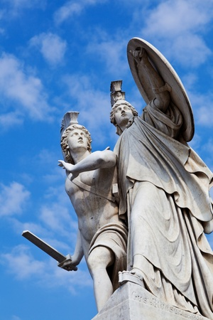 Pillar Statue in Schlossbrücke Bridge in Berlin by Gustav Blaeser (1854) which shows a young hero protected by Athena. photo