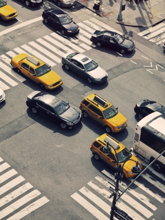 citylife: Typical yellow cabs and other cars in the streets of Manhattan