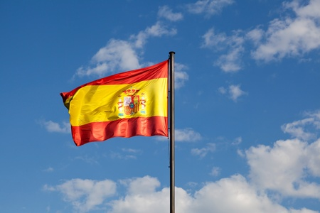 Spanish Flag in a Blue Sky photo