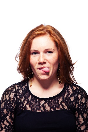 Cute Redhead Girl Showing her Tongue photo