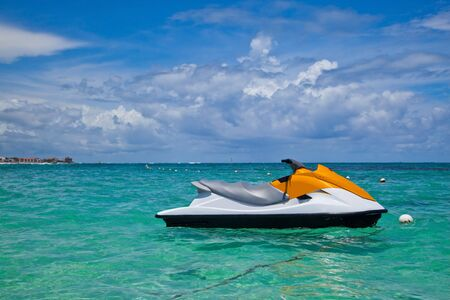 jet ski: Jet Ski Moored in the Caribbean Sea Stock Photo
