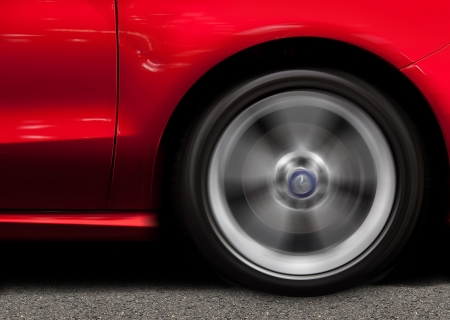 alloy wheel: Red Sports Car in Motion