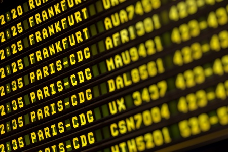 Flights information timetable in airport terminal