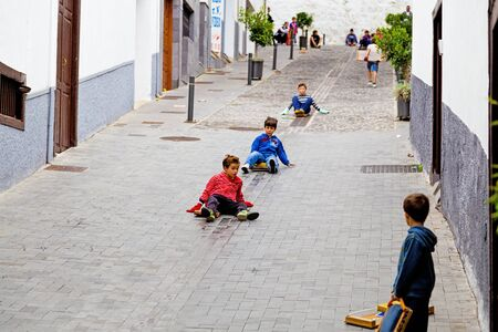 municipalities: ICOD DE LOS VINOS, SPAIN - NOVEMBER 18  Childrens playing con wooden planks in the streets of Icod de los Vinos on November 18, 2012  Tradition feature in honor of San Andres of the municipalities of Icod and The Guancha on the island of Tenerife  Canary