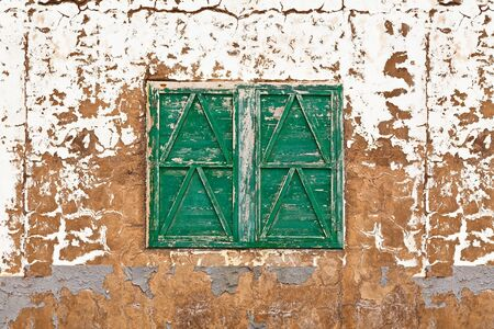 Closed Wooden Window in an Abandoned House photo