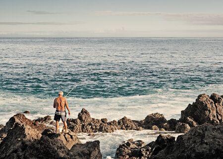 Old Man Fishing in Puerto de la Cruz, Tenerife Stock Photo - 17103999