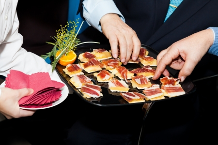 People on a Catering Eating Canapes