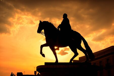 carlos: Sunset in Puerta del Sol, Madrid with the equestrian statue of Carlos III at the right