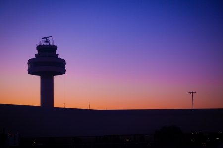 runway: Airport Control Tower at a Beatiful Sunset