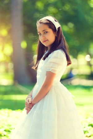 Portrait of a Cute Little Girl in her First Communion Day photo